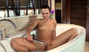 Sexy slim handsomeness brings her fiery slit to pleasure while alluring a bath