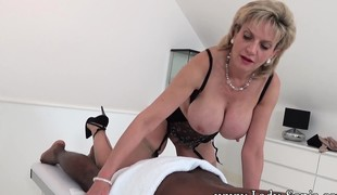 Prexy blonde milf in undergarments works her lips and hands overhead a dusky unearth