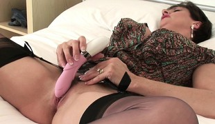 Big breasted married lady in lingerie fucks her peach round a pink toy
