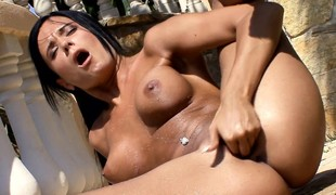 Gorgeous coupled with horny brunette cools off her pussy beneath get under one's hot sun