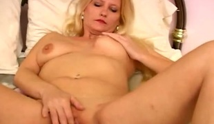 Shaved milf pussy pleasured unconnected with fingers and a toy