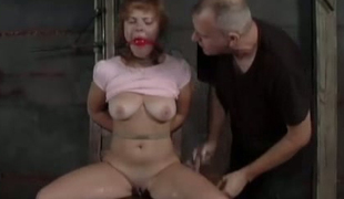 Young red haired gal Natalia is fucked prevalent sex toy in the basement