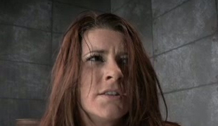 Red haired sex-slave is punished at hand nipple clamps